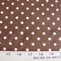 Pink polka dots on chocolate brown cotton